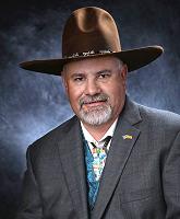 Headshot of man in large hat
